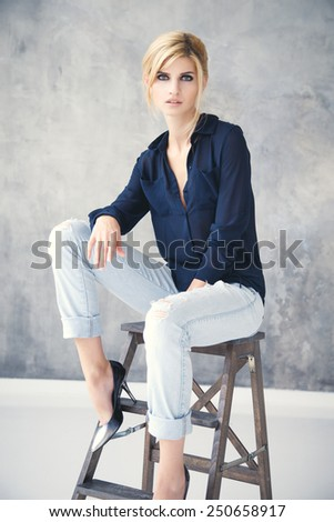 Beautiful blonde young woman in casual style. Fashion model - stock photo