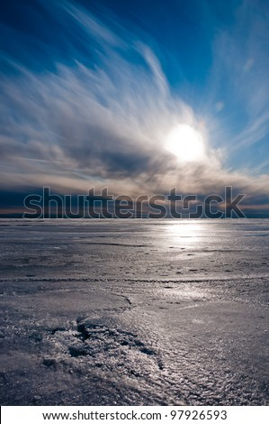 Beautiful blue and cloudy sky over ice lake in Saint-Petersburg, Russia - stock photo