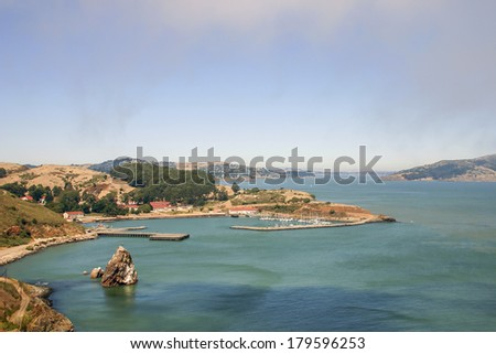 Beautiful blue bay with yacht harbor in evening sun - stock photo