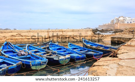 Beautiful blue boats in Essaouira old harbor, Morocco - stock photo
