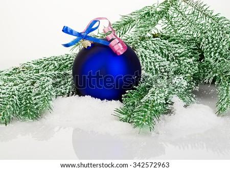 Beautiful blue Christmas ball on frosty fir tree. - stock photo