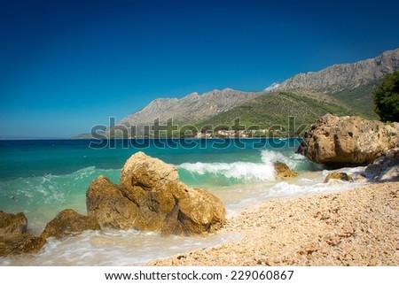 beautiful blue dalmatian coast with sea waves, croatia - stock photo
