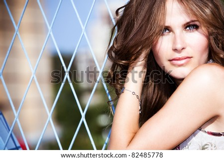 beautiful blue eyes woman outdoor portrait, summer sunny day - stock photo
