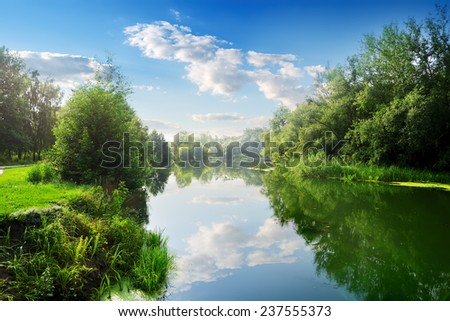 Beautiful blue river in the summer day - stock photo