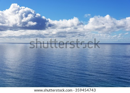 Beautiful blue sea, ocean, water and white puffy clouds. California Central Coast. - stock photo