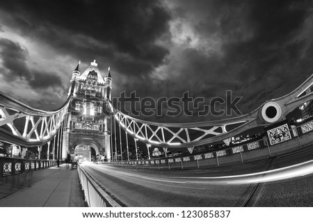 Beautiful blue shades of Tower Bridge at sunset in London, wide angle view. - stock photo