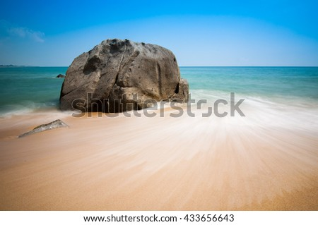 Beautiful blue sky view over seascape of Terengganu, Malaysia. Soft focus due to long exposure shot. Copy Space Area - stock photo