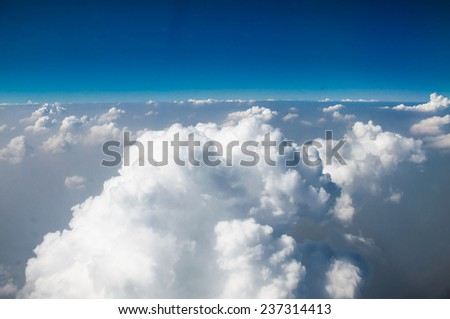 Beautiful blue sky with clouds, view from plane - stock photo
