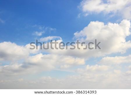beautiful blue sky with puffy clouds - stock photo
