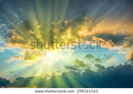 Beautiful blue sky with sun shining through clouds - stock photo