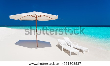 beautiful blue sun sea tropical nature background holiday luxury  resort island atoll about coral reef amazing  fresh  fantastic freedom snorkel adventure Fiji sunbed umbrella parasol spa. Coconuts   - stock photo