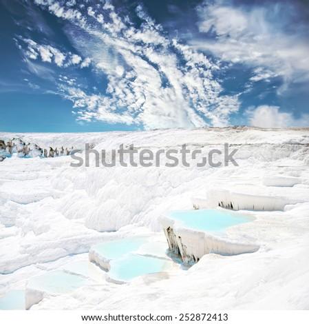 Beautiful blue travertine pools and terraces in Pamukkale Turkey - stock photo