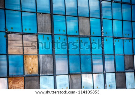 Beautiful blue windows in old vintage factory - stock photo