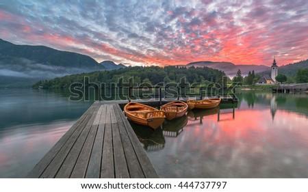 Beautiful Bohinj lake on a vivid sunrise - stock photo