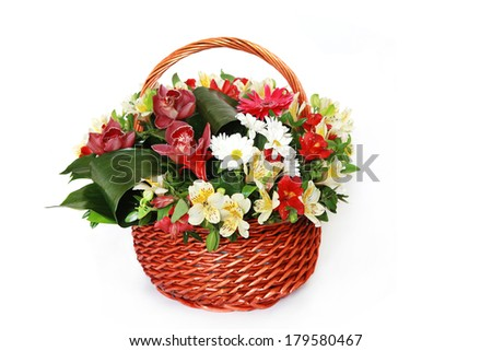 Beautiful bouquet of bright flowers in basket , isolated on white background - stock photo
