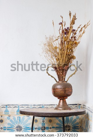 Beautiful Bouquet of dried flowers in east style vase on light background  - stock photo