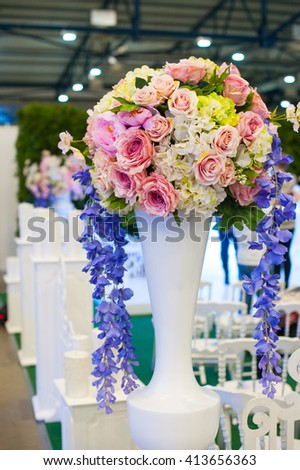 Beautiful bouquet of flowers at the wedding table in a restaurant decor - stock photo