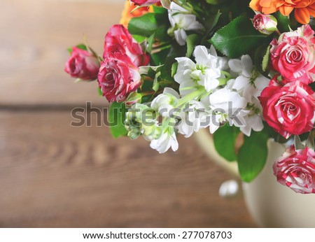 beautiful bouquet of flowers in a vase, toned image. - stock photo
