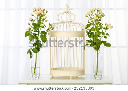 Beautiful bouquet of flowers in vases on window background - stock photo