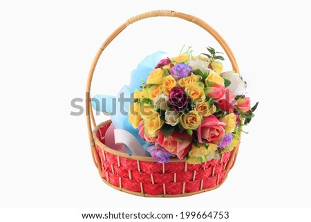 Beautiful bouquet of freesias in basket, isolated on white - stock photo