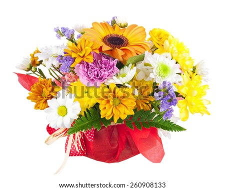 Beautiful bouquet of gerbera, carnations and other flowers in red  package isolated on white background. - stock photo