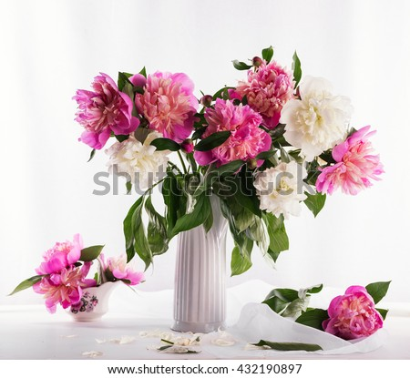 Beautiful bouquet of pink and white peonies on a white background - stock photo