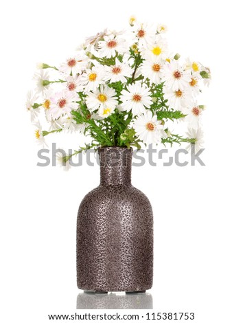 beautiful bouquet of white flowers in vase isolated on white - stock photo