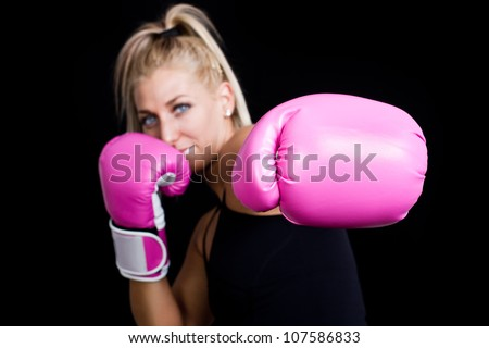 beautiful boxing girl wearing pink gloves - focus on hand - stock photo