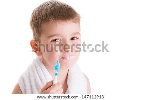 Beautiful boy brushing teeth, isolated on white - stock photo