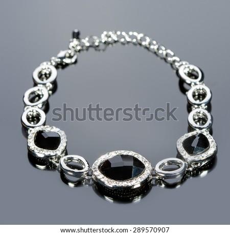 beautiful bracelet on gray background.  - stock photo