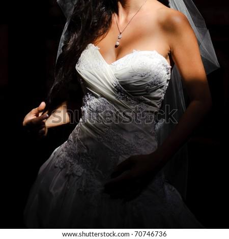 beautiful breasts in a wedding dress closeup - stock photo