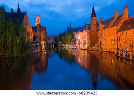 Beautiful brick architecture is reflected in the canal in front of RozenhoedKaai in the old city portion of Brugge, Belgium - stock photo