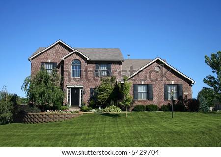 beautiful brick two-story house - stock photo