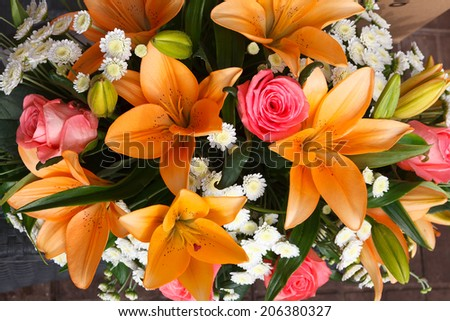 beautiful bridal bouquet of lilies and roses at a wedding party  - stock photo