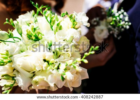 Beautiful bridal bouquet with the white roses - stock photo