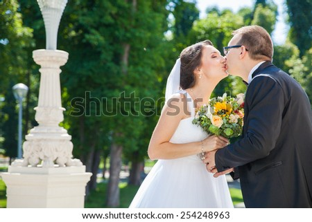 Beautiful bride and groom - stock photo