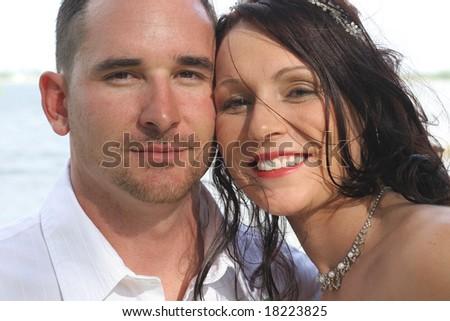 beautiful bride and husband headshot - stock photo