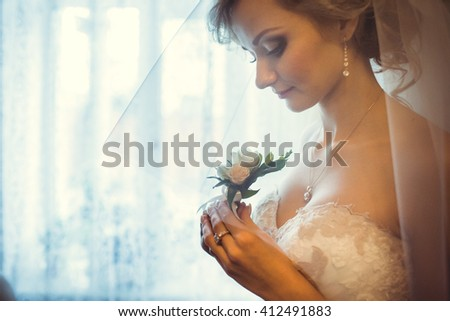beautiful bride by the window - stock photo