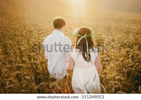 Beautiful Bride hugs groom on nature in the sunset light, wedding, marriage, relationship, lifestyle - stock photo