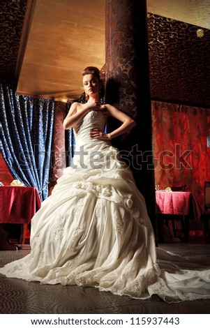 Beautiful bride in a luxurious restaurant. Vintage style. - stock photo