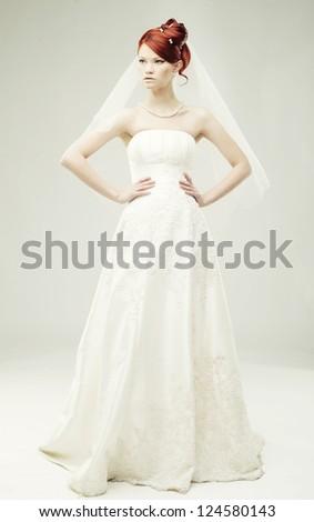 beautiful bride in a luxurious wedding dress, studio shot - stock photo