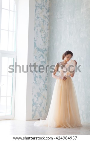 Beautiful bride in ivory wedding dress - stock photo