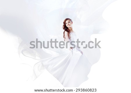 Beautiful bride in wedding dress, abstract soft background    - stock photo