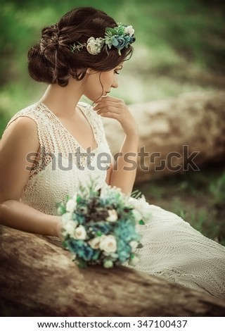 Beautiful bride in white dress in the garden  - stock photo