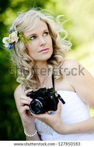 Beautiful bride is enjoying her wedding day - stock photo
