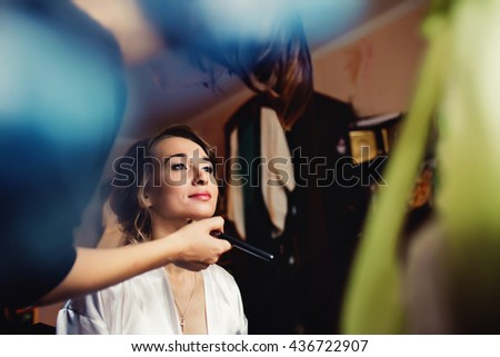 Beautiful bride is preparing for her wedding - stock photo