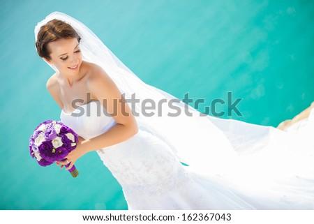 Beautiful bride outdoors - stock photo