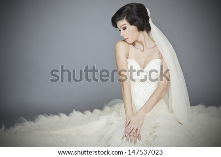 beautiful bride portrait in studio with gray background - stock photo