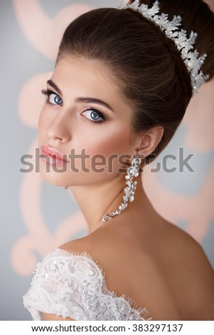 Beautiful Bride portrait wedding makeup and hairstyle with diamond crown, fashion bride model jewelry and beauty girl face, gorgeous beauty bride, isolated , studio, series. - stock photo