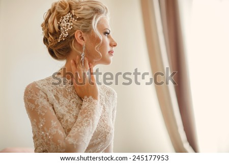 Beautiful Bride Portrait wedding makeup hairstyle, gorgeous young woman in white dress at home. series.  - stock photo